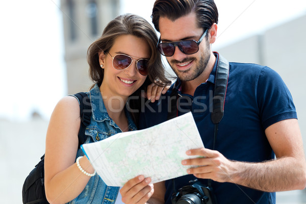 Young tourist couple in town holding a map. Stock photo © nenetus