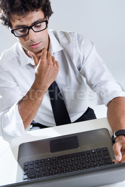 Executive thinking in front of his laptop Stock photo © nenetus
