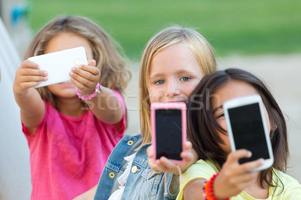 Group of childrens taking a selfie in the park. Stock photo © nenetus