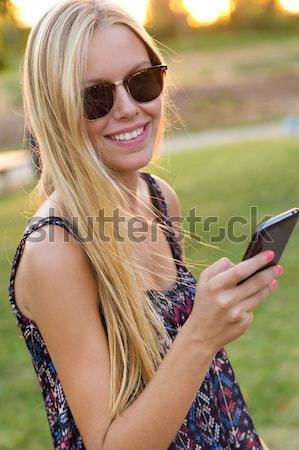 Pretty young girl taking selfies with her smart phone in the gar Stock photo © nenetus