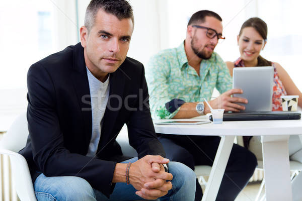 Confident businessman in office with his team. Stock photo © nenetus