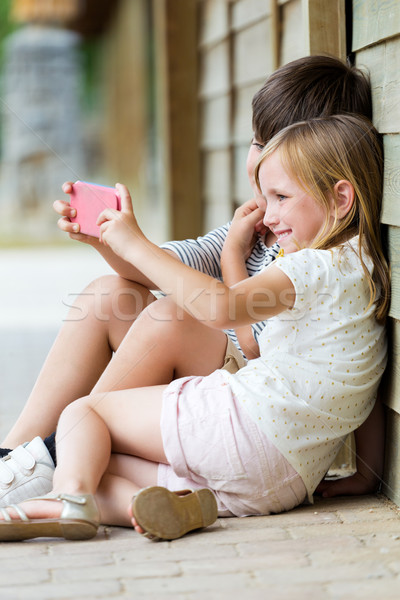 Happy young brothers taking selfies with her smartphone in the p Stock photo © nenetus