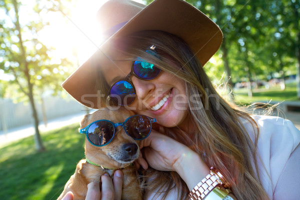 Beautiful young woman looking at camera with her dog. Stock photo © nenetus