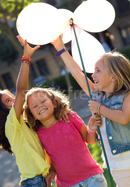 Group of childrens having fun in the park. Stock photo © nenetus