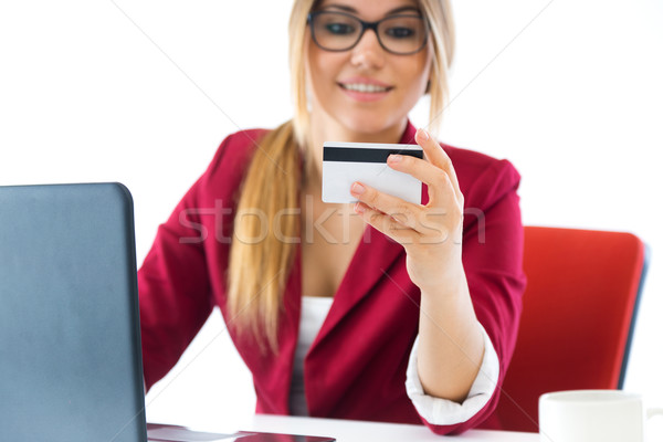 Young business girl using her computer. Stock photo © nenetus