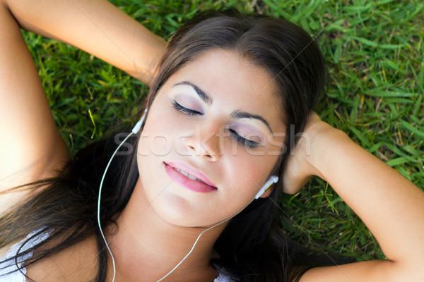 Nő zenét hallgat fű szép fiatal nő lány Stock fotó © nenetus