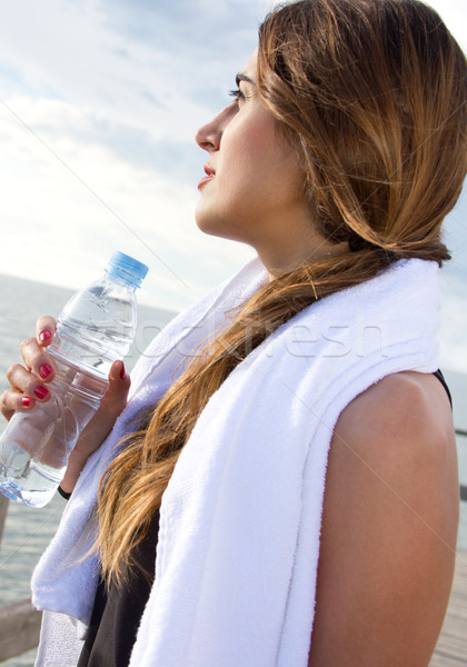 Woman drinking water after sport activities Stock photo © nenetus
