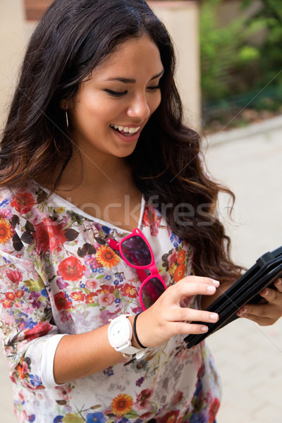 Pretty student girl surfing the Internet. Stock photo © nenetus