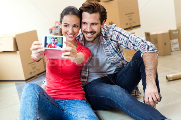 Young couple  taking selfies in their new home Stock photo © nenetus
