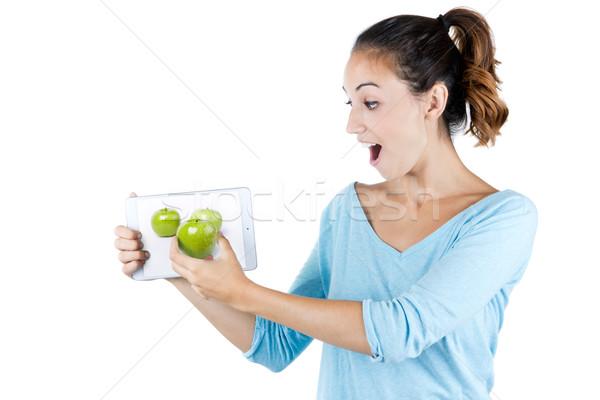 Jeune femme bon définition numérique comprimé écran Photo stock © nenetus
