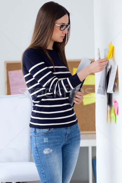 Confident young woman working in her office. Stock photo © nenetus