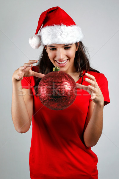 Stock photo: Magical santa girl floats a christmas ball