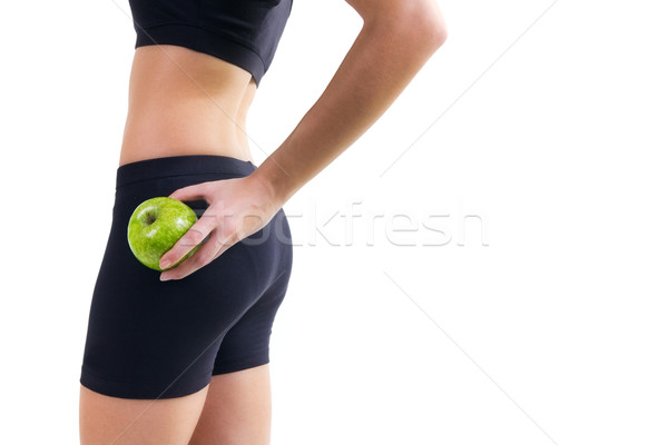 Woman in fitness clothes holding an apple Stock photo © nenetus