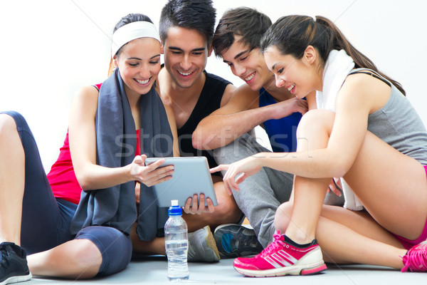 young people looking at digital table in the gym after making ex Stock photo © nenetus