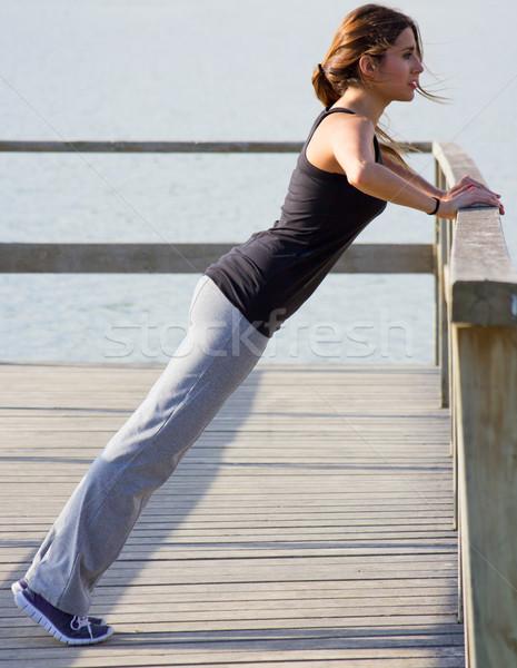 Young woman doing push ups near the sea Stock photo © nenetus