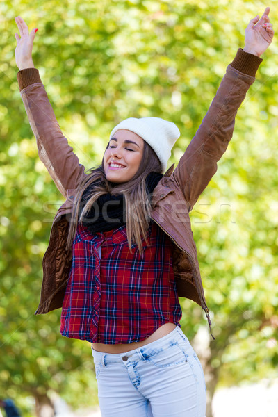 Portrait of beautiful girl standing in autumn field with arms ra Stock photo © nenetus
