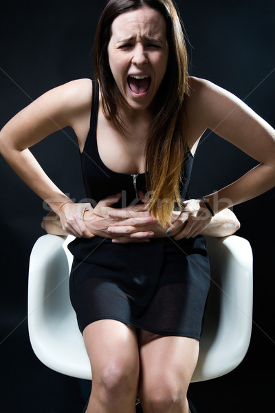 Young woman in a chair caught by a male arms. Concept of oppress Stock photo © nenetus