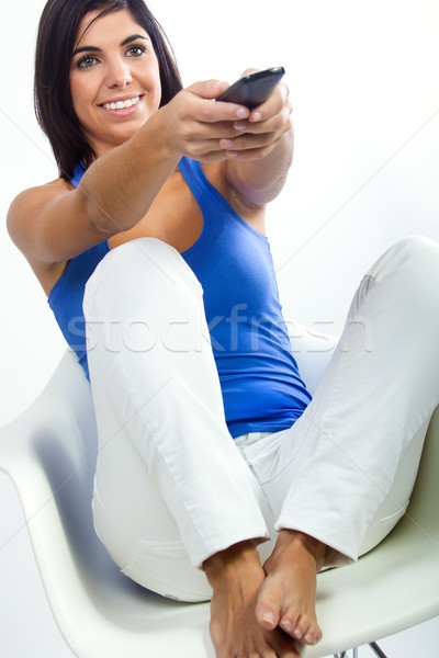 pretty latin woman using the TV's remote to change channels Stock photo © nenetus