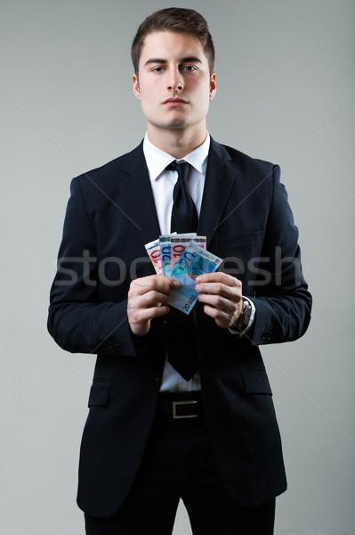 Young man in formalwear holding money. Stock photo © nenetus