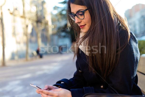 Jovem bela mulher telefone móvel rua ao ar livre retrato Foto stock © nenetus