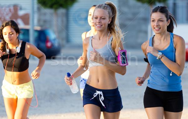 Group of women running in the park. Stock photo © nenetus