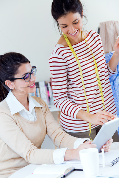 Two young businesswomen working with digital tablet in her offic Stock photo © nenetus
