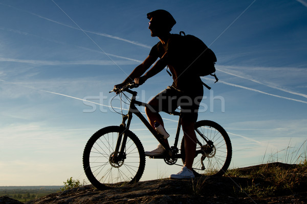 Young man riding mountain bike Stock photo © nenetus