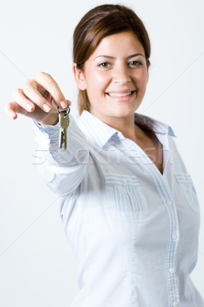 Woman or real estate agent showing keys from new house Stock photo © nenetus