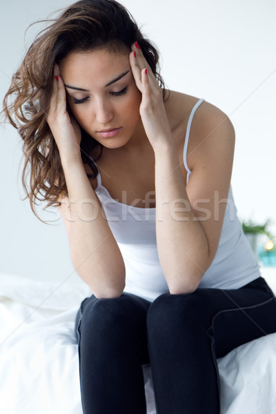 Stock photo: Young woman suffering from insomnia in the bed.