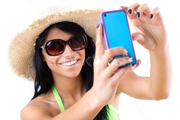 Pretty young girl with green bikini taking selfies with her smar Stock photo © nenetus