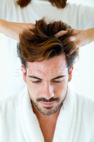 Masseur doing massage on man body in the spa salon. Stock photo © nenetus