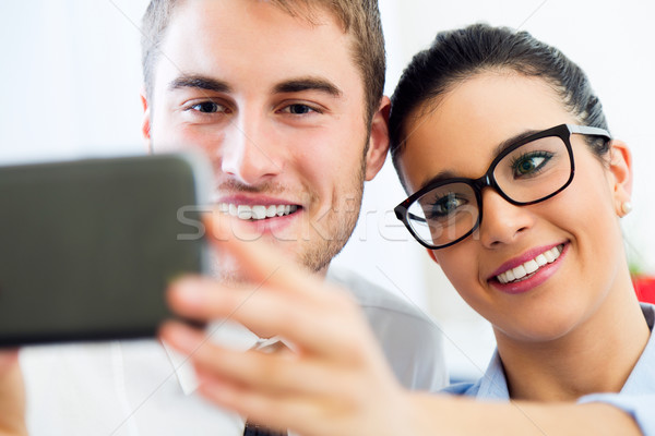 Business people taking a selfie in the office. Stock photo © nenetus