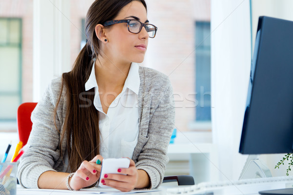 Young businesswoman working in her office with laptop. Stock photo © nenetus