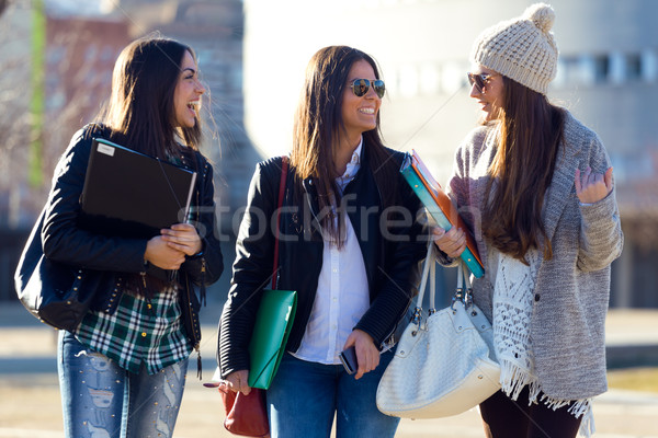 Three students girls walking in the campus of university. Stock photo © nenetus