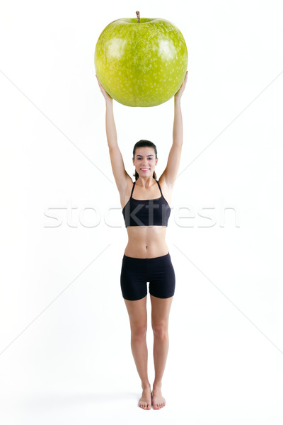 Slender woman in fitness clothes holding a giant apple Stock photo © nenetus