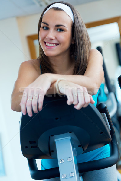 Young woman with elliptic machine in the gym. Stock photo © nenetus