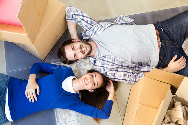 Young couple moving in new home  Stock photo © nenetus