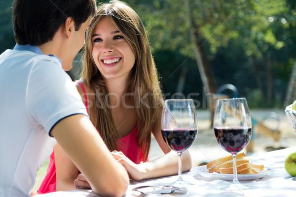 Attractive couple on romantic picnic in countryside. Stock photo © nenetus