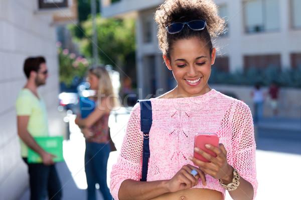 Belo estudante menina telefone móvel rua retrato Foto stock © nenetus