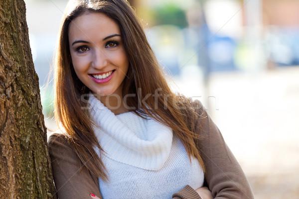 Beautiful girl looking at camera in autumn. Stock photo © nenetus