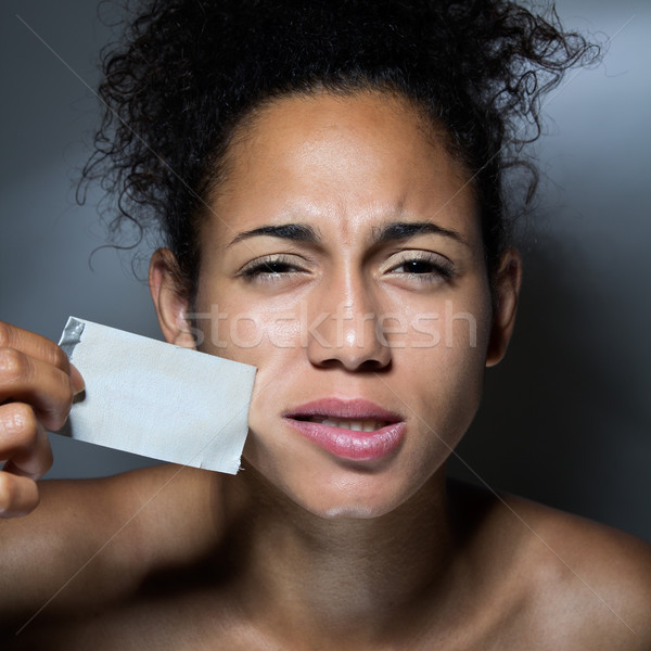 black woman with mouth covered with tape Stock photo © nenetus