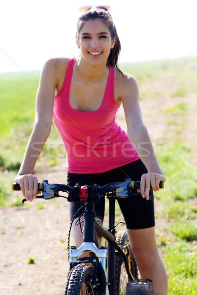 Fit woman riding mountain bike Stock photo © nenetus