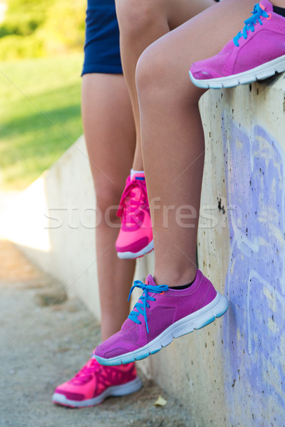 Tired women runner taking a rest after running hard in the park. Stock photo © nenetus