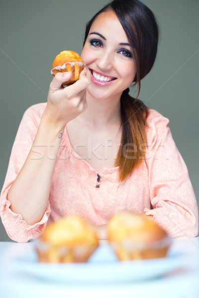 Happy young Woman eating delicious muffins Stock photo © nenetus