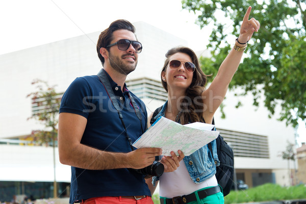 Young tourist couple use their map and pointing where they want  Stock photo © nenetus