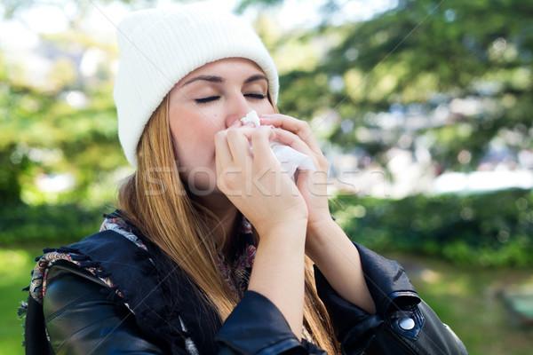 Portrait of beautiful girl with tissue having flu or allergy. Stock photo © nenetus