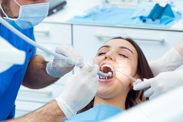 Bonitinho mulher jovem dentista boca médico cena Foto stock © nenetus