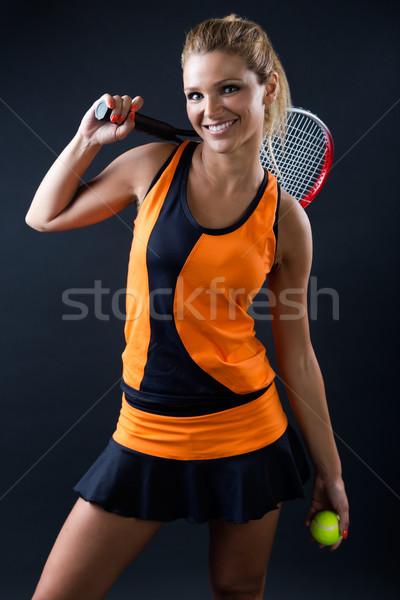Sportos tinilány teniszező ütő izolált fekete Stock fotó © nenetus