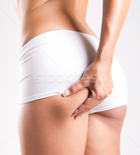 Woman with perfect body checking cellulite Stock photo © nenetus