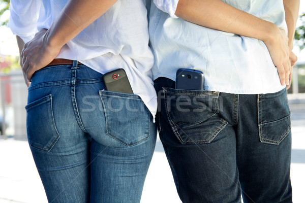 back portrait of young couple with mobile in the pocket Stock photo © nenetus